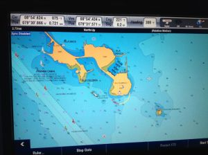 1. On this photo of Joyful's chart plotter, you can see the actual spot (look for the white boat shaped icon) where Joyful anchored at the Isla Flamenco anchorage on the west side of the island and the fuel dock in the marina on the north side.