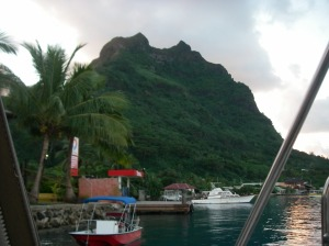 16. Joyful's view of Mt. Pahia of Bora Bora to starboard. The prevailing winds came from the East, on the far side of this volcanic peak.  We could look at the color of the clouds as they blew over the crest, to determine if it would rain!