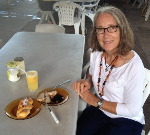 17. At an outdoor cafe near Joyful's anchorage, Anne enjoyed a typical Nuku Hivan breakfast of red tuna, brioch, and pinneaple juice.  Every day, Anne wore the lovely seed lei Emmanuel gave her as a welcome to Nuku Hiva.  Thank you, Emmanuel!