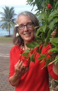 25. Friendly Nuku Hivan locals gave Anne sweet tiara flowers to wear in her hair and by her ear.  Anne posed with hibiscus flowers near the church for this photo in Nuku Hiva.