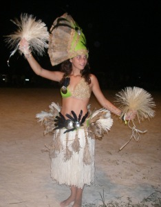 27. The beautiful Polynesian dancer, Tamatea, from the Faanui dance troup.  Banana leaves, feathers, and shells making up her clothes had to be from French Polynesia, and locally made as well. Her mother and grandmother made the traditional clothes.