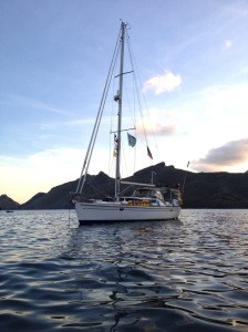 3. Joyful anchored in Nuku Hiva, protected on three sides by volcanic mountains.