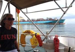 3. Joyful carefully made way under engine in the Southbound lane of the busy shipping channel leading in and out of the Panama Canal and Isla Flamenco area into the Pacific Ocean.  Anne wore the tee shirt from one of Joyful's schools, the Hun School.