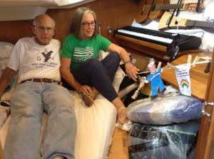 34. Jeff, Anne, and Flat Mr. Davis with NOAA drifter buoy in Joyful's aft stateroom before its deployment in the South Pacific Ocean near the Galapagos Archipelago.