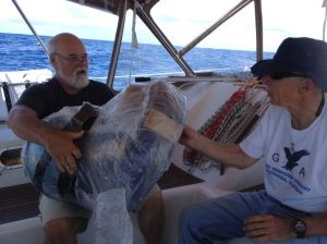 35. Jeff and Bill removed the plastic wrap from the NOAA drifter buoy.