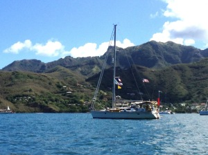 4. Joyful anchored in a submerged volcanic crater in Nuku Hiva with beautiful, lush volcanic mountains in the background.