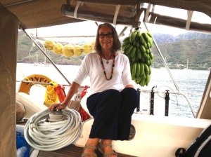45. Anne sat in Joyful's cockpit next to Conchita's present of pamplemousse and bananas she grew.  Thank you Conchita!