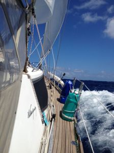 53. Joyful's bow wave in eight foot following seas.