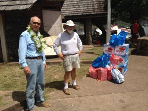 62. Bill and Jeff stood next to boxes of water and other provisions for Joyful.  Jeff is wearing the magnificent flower lei Conchita just gave him as a gesture of friendship and for a bon voyage.