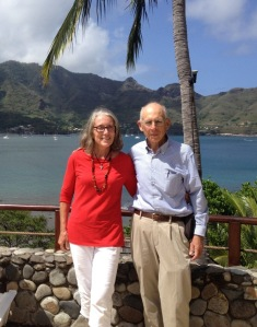 63. For this photo, Jeff and Anne in Nuku Hiva posed under a coconut tree with Joyful anchored in the distance.
