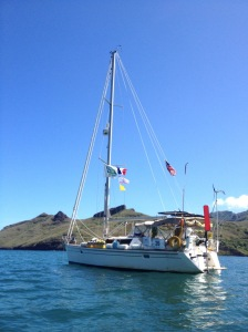 7. Joyful, in Nuku Hiva, with 40 days of sea growth on her hull where the blue antifouling paint was not applied.  Anne easily removed the growth with a plastic scraper and a sponge.