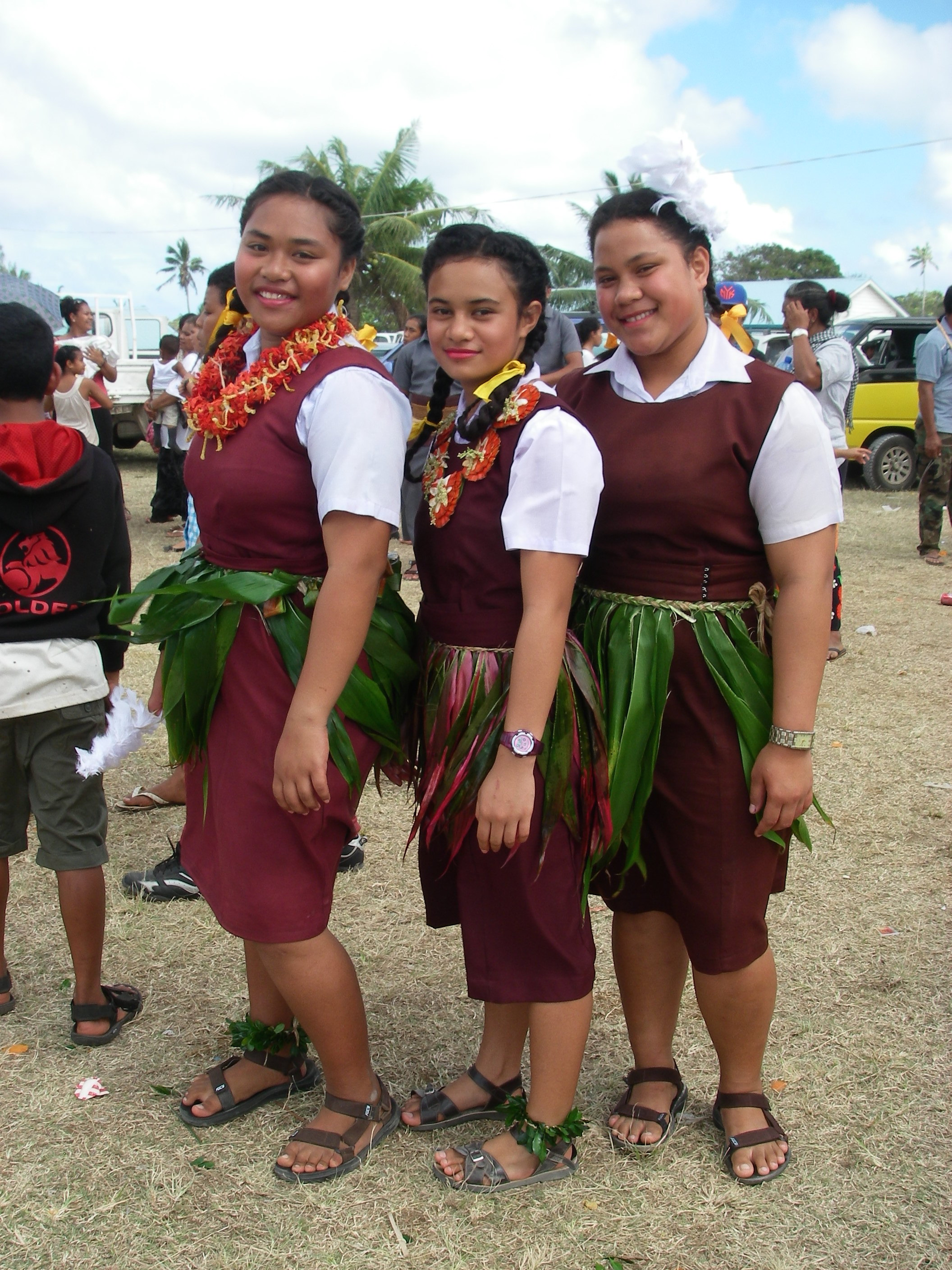 107. These pretty Tongan school girls wore traditional woven leis and ta'ovalas with their school uniforms