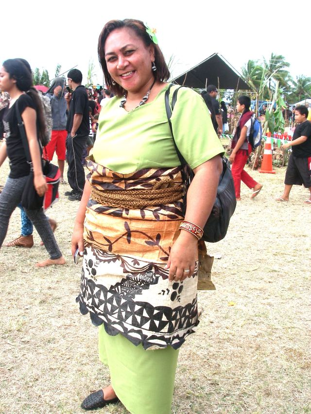 108. A magnificent ta'ovala made of tapa cloth, laboriously made from bark of special trees, graces this pretty Tongan woman. Tapa is a special way to honor Tongan royalty. It is highly valued and passed down from generation to generation