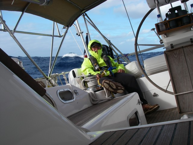 15. During the infrequent days and some nights that we experienced cool air temperature and high seas, we wore our heavy duty ocean foul weather gear.  Bill liked to sit in this location while Joyful was on a port tack.