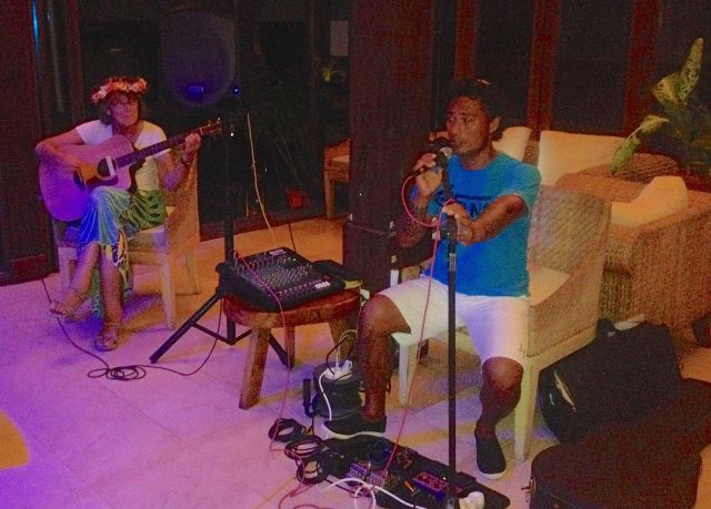 53. Anne played a guitar and Henri sang Amazing Grace at the MaiKai Yacht Club..  Henri sang the words in Polynesian