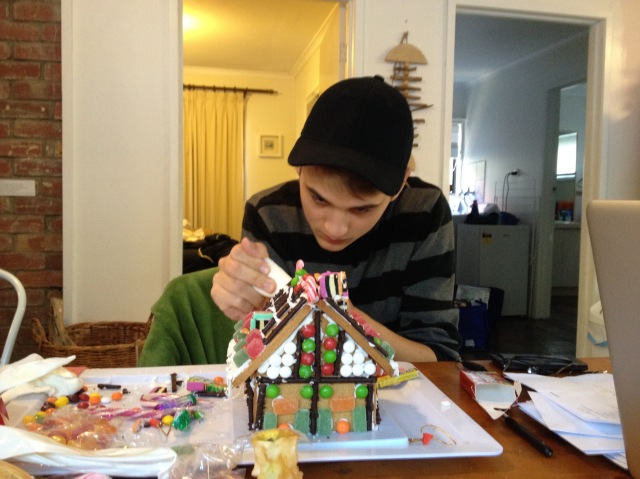 125. Seventeen year old Josh making the gingerbread house he graceously gave to residents of an elder care facility on Phillip Island, Australia copy