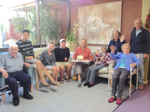 130.1. Presentation of Beatrice's gingerbread house to residents of the Melaleuca Aged Care Center. They thanked us and prayed for our safe journies on the oceans.