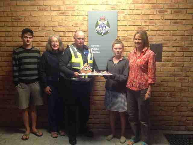 131.1. Gabriella kindly giving her gingerbread house to the Police Station on Phillip Island, Australia. The officer was extremely thankful and awestruck that a young teenager would wis