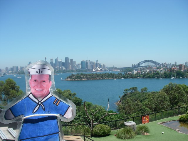 52.1. Flat Mr. Davis, Jeff and I one day took a ferry boat to the Toronga Zoo in Sydney. Here, Flat Mr. Davis, from the zoo, overlooked Sydney Harbor towards the city, Sydney Opera Hous